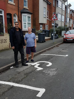 Liberal Democrat campaigner Baber Baz with a local resident